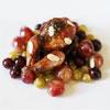 Caille laquée au citron confit, raisins et olives caramélisées