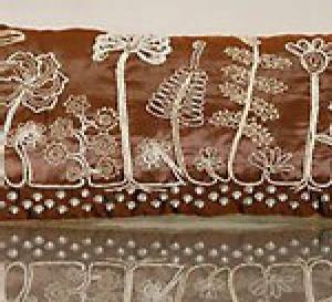 Réalisez un coussin avec broderie motif paysage exotique